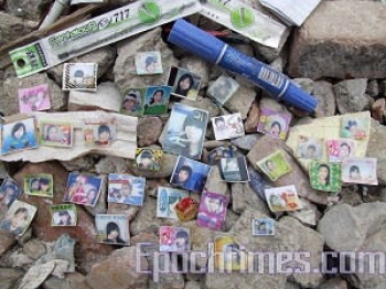 Makeshift memorial using photos and memorabilia left behind from children who died in Beichuan Primary School's ruins. (The Epoch Times)